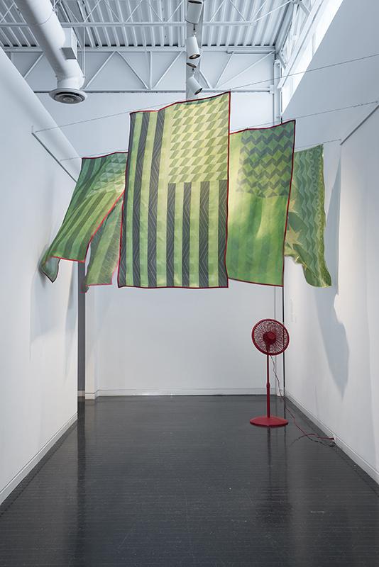 Edra Soto, Tropicalamerican, 2015. Inkjet print on silk, plastic fan.  Installation at the Elmhurst Art Museum Biennial. Photo by James Prinz. Courtesy of the artist. ©Edra Soto.