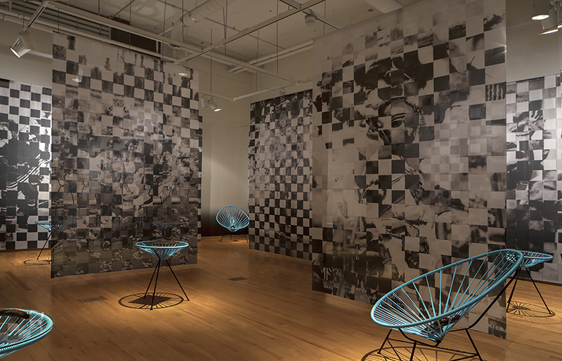 Maria Gaspar, Brown Brilliance Darkness Matter, 2016.  Installation detail at the National Museum of Mexican Art in Chicago. Woven Collage on Digitally Printed Dye Sub Fabric, White Stoneware, Cone 6, Oxidation, Brown Overglaze, Acapulco Furniture, 2016, Photo Credit: Sara Pooley. Courtesy of the artist.
