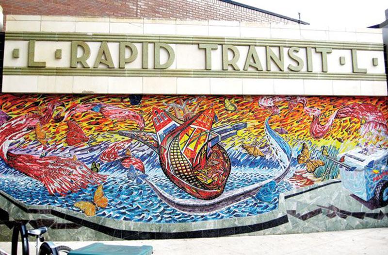 Héctor Duarte, Ice-Cream Dream / Sueño de un Carrito de Paletas, 2004. Glass mosaic with ceramic insets, 8 ft. 10 in. x 24ft.  8.5 in. Western (Douglas) Station. Photo Courtesy of the CTA Arts in Transit Program